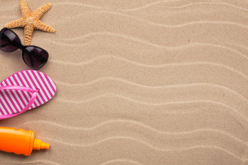 Accessories for the beach lying on the sand, with place for your