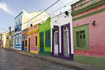 Cobbled street in historic city Olinda with colourful houses