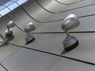 Halogen metal reflectors on modern building grey wall
