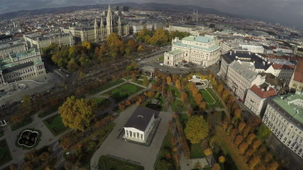 Bird's eye view on park in Vienna. Rathaus and National Theater