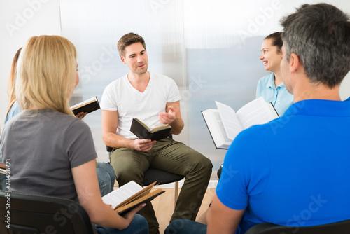 Leinwandbild Motiv Man Explaining Gospel