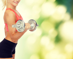close up of sporty woman with heavy steel dumbbell