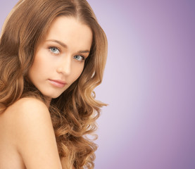 beautiful young woman over violet background