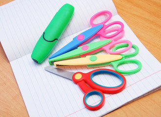 colorful scissors on a notebook
