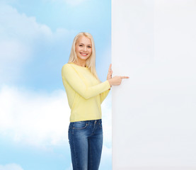 smiling woman in sweater with blank white board
