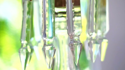 Luxury crystals, classic chandelier close up with green backgrou