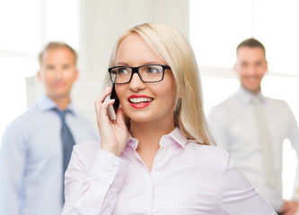 smiling businesswoman calling on smartphone