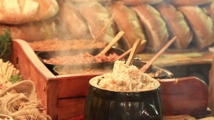 Traditional Polish food - Smalec at Christmas fair in Krakow