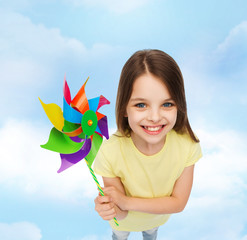 smiling child with colorful windmill toy