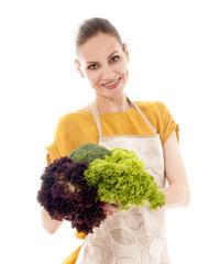 Young smiling girl holding fresh vegetables, over white backgrou