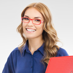Smiling businesswoman in glasses with red folder, on gray