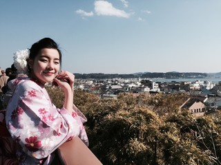 japanese girl and kamakura cityscape
