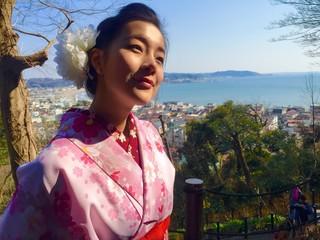 cute girl and kamakura cityscape