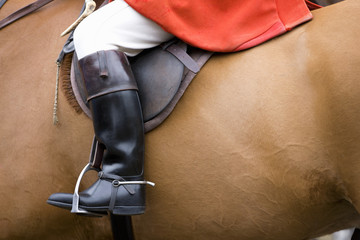 Close-up of boot of rider on horseback