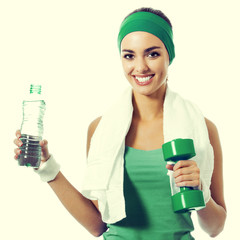 Woman with dumbbell and water