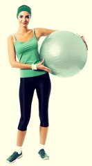 Cheerful smiling woman with fitball