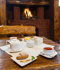 Romantic breakfast for two near fireplace