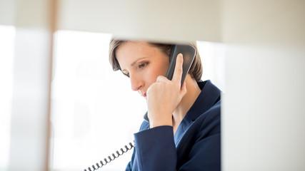 Businesswoman Talking to Someone Using Telephone