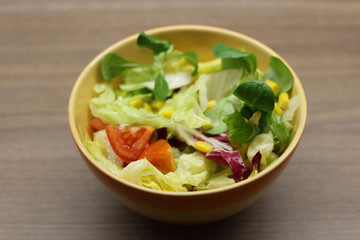 Mixed leaves and tomato salad in a bowl