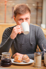Handsome young man in cafe