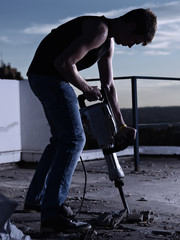 Construction worker with drilling machine