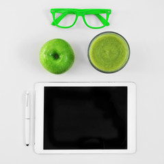 eyeglasses, apple, smoothie and tablet computer
