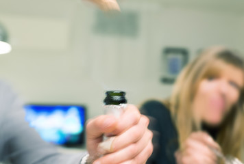 Blurred image of man hand opening a champaign bottle