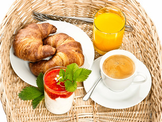 Breakfast with coffee, croissant and orange juice