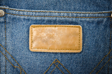 Close up tag on jeans background texture