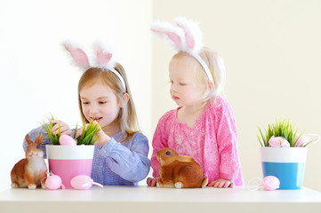 Two sisters wearing bunny ears on Easter