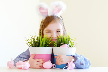 Adorable little girl wearing bunny ears on Easter
