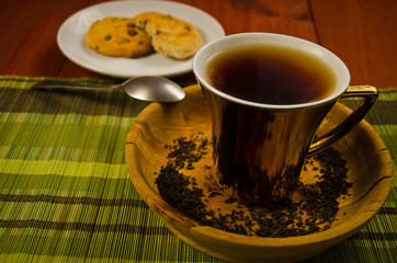 tea with coockies on wooden table