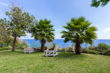 Vacation resort with seats near the sea at Madeira Island