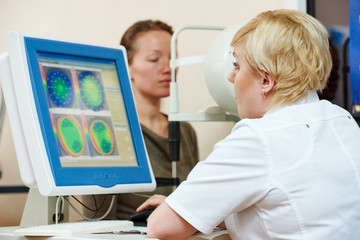 Ophthalmologist or optometrist optician at work