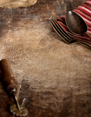 Vintage fork and spoon on wooden background