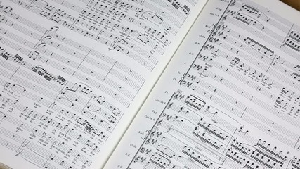 Sheet music with conductor's baton