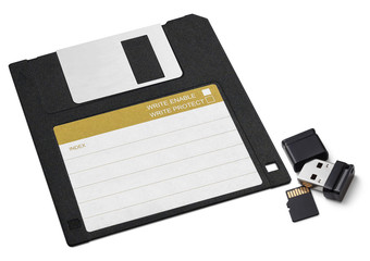Diskette, small USB flash memory and flash card. On a white back