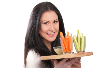Smiling hostess with healthy vegetable dip on tray
