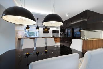 Modern kitchen interior design with black table