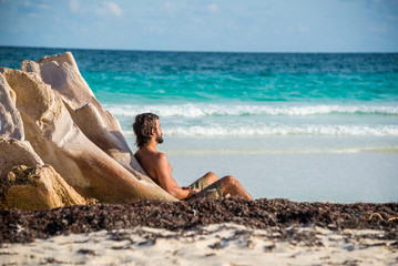 Young Male Meditating besides Caribbean Sea. At Tulum, Mexico.
