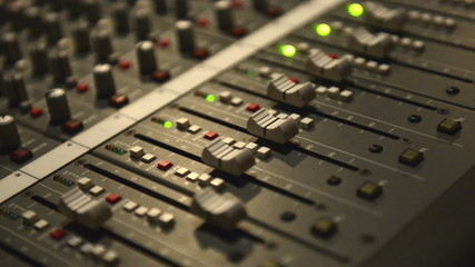 Analog audio mixing board with several channels