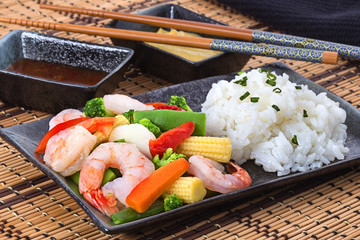 Shrimp stir fry with vegetables and rice