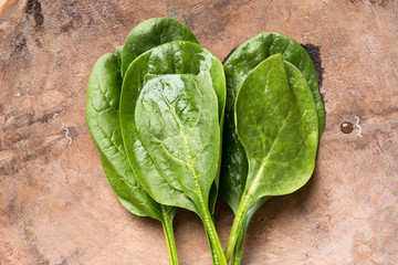 Raw Spinach in Wood Bowl