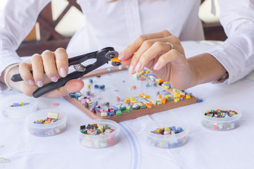 Woman working in art studio with colorful mosaic