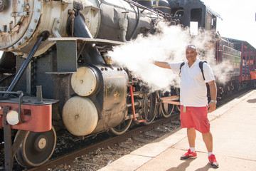 Tourist portrait in Steam Locomotive in Remedios,Cuba