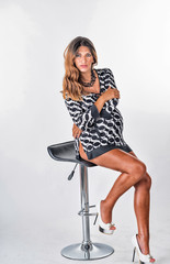 Pregnant woman sitting on the stool