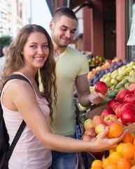 Young couple choosing fruits