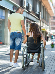 Social worker taking invalid for a walk