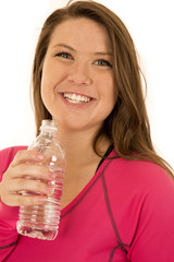 Young female model holding a bottled water smiling