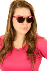 Young female model wearing pink top and sunglasses